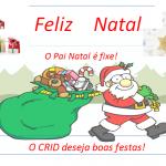 Feliz Natal a vermelho no topo, em baixo pai Natal é fixe e o pai natal a arrastar um saco de presentes. O CRID deseja boas festas a vermelho.